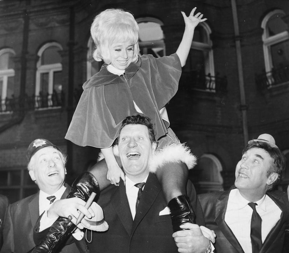 15th December 1969: British film and television stars (left to right) Hughie Green, Barbara Windsor, Tommy Cooper and Frankie Howerd promoting ITV's Christmas programmes. (Photo by Frank Barratt/Keystone/Getty Images)