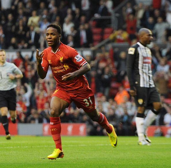 Raheem Sterling celebrates his goal during the Capital One Cup second round match between Liverpool and Notts County at Anfield on August 27, 2013 in Liverpool, England. (via Getty Images)