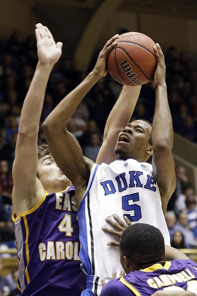 Duke's Rodney Hood (5) shoots as East Carolina's Marshall Guilmette, left, and Paris Roberts-Campbell defend during the second half of an NCAA college basketball game in Durham, N.C., Tuesday, Nov. 19, 2013. Duke won 83-74. (AP Photo/Gerry Broome)