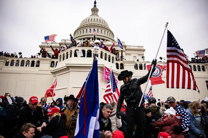<p>Rioters swarm the US Capitol on 6 January, 2021</p> (Getty Images)