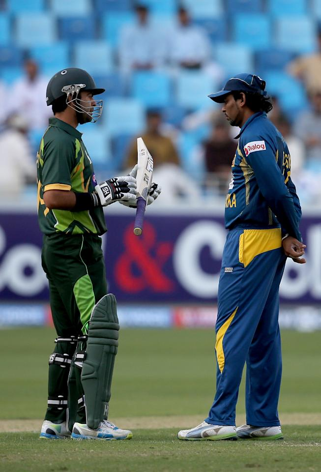 DUBAI, UNITED ARAB EMIRATES - DECEMBER 20:  Ahmed Shahzad (L) of Pakistan shares a moment with TM Dilshan (R) of Sri Lanka during the second One-Day International (ODI ) match between Sri Lanka and Pakistan at the Dubai Sports City Cricket Stadium on December 20, 2013 in Dubai, United Arab Emirates.  (Photo by Francois Nel/Getty Images)