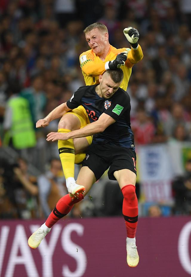 <p>Jordan Pickford of England collides with Ante Rebic of Croatia during the 2018 FIFA World Cup Russia Semi Final match between England and Croatia at Luzhniki Stadium on July 11, 2018 in Moscow, Russia. (Photo by Shaun Botterill/Getty Images) </p>