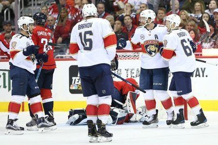 Oct 19, 2018; Washington, DC, USA; Florida Panthers left wing Jonathan Huberdeau (11) celebrates with teammates after scoring a goal on Washington Capitals goaltender Pheonix Copley (1) in the second period at Capital One Arena. Mandatory Credit: Geoff Burke-USA TODAY Sports