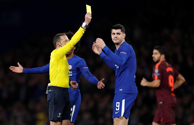 Soccer Football - Champions League Round of 16 First Leg - Chelsea vs FC Barcelona - Stamford Bridge, London, Britain - February 20, 2018 Chelsea's Alvaro Morata is shown a yellow card by referee Cuneyt Cakir Action Images via Reuters/Matthew Childs