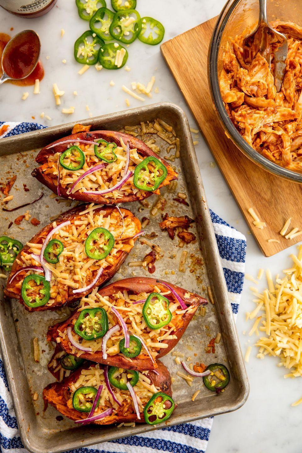 """<p>These twice-baked potatoes are loaded with the makings of a full chicken dinner.</p><p>Get the recipe from <a href=""""https://www.delish.com/cooking/recipe-ideas/recipes/a49187/barbecue-chicken-sweet-potatoes-recipe/"""" rel=""""nofollow noopener"""" target=""""_blank"""" data-ylk=""""slk:Delish"""" class=""""link rapid-noclick-resp"""">Delish</a>.</p>"""