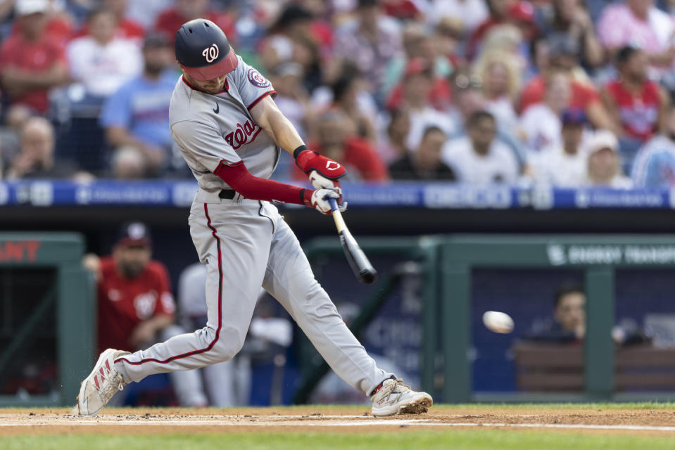 Washington Nationals' Trea Turner hits a single during the first inning of the team's baseball game against the Philadelphia Phillies, Tuesday, July 27, 2021, in Philadelphia. (AP Photo/Laurence Kesterson)