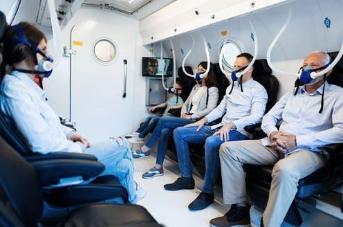 """<span class=""""caption"""">People wearing masks while having oxygen therapy in hyperbaric chamber.</span> <span class=""""attribution""""><a class=""""link rapid-noclick-resp"""" href=""""https://www.shutterstock.com/image-photo/group-mixed-age-people-wearing-masks-1400143358"""" rel=""""nofollow noopener"""" target=""""_blank"""" data-ylk=""""slk:Drazen Zigic/Shutterstock"""">Drazen Zigic/Shutterstock</a></span>"""