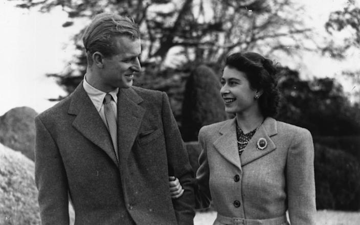 Princess Elizabeth and Prince Philip, the Duke of Edinburgh enjoying a walk during their honeymoon in Hampshire - Hulton Archive/Getty Images/Topical Press Agency