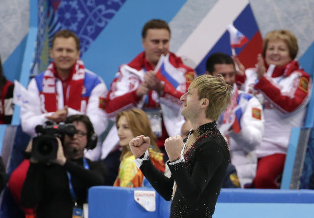 Evgeny Plyushchenko of Russia celebrates after competing in the the men's team short program figure skating competition at the Iceberg Skating Palace during the 2014 Winter Olympics, Thursday, Feb. 6, 2014, in Sochi, Russia. (AP Photo/Bernat Armangue)