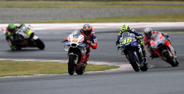 Motorcycle Racing - Argentina Motorcycle Grand Prix - MotoGP Qualifying Session - Termas de Rio Hondo, Argentina - April 7, 2018 - Alma Pramac Racing rider Jack Miller of Australia races ahead of Movistar Yamaha rider Valentino Rossi (46) of Italy and Ducati Team rider Andrea Dovizioso (04) of Italy during the qualifying session. REUTERS/Marcos Brindicci