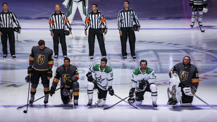 Ryan Reaves, Jason Dickinson, Tyler Seguin and Robin Lehner took a knee prior to Monday's Stars-Golden Knights game. (Getty)