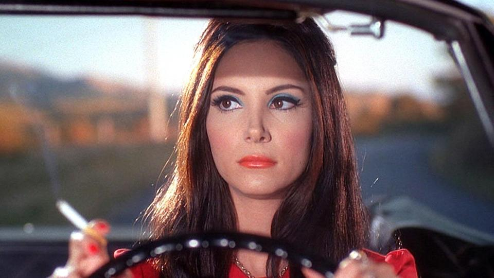 <p> An homage to '60s Technicolor, The Love Witch is a sexy, stylish experience, with the dreamy, woozy visuals and general unease creating a feeling of being drugged. The Love Witch introduces us to Elaine, a young witch who uses witchcraft to find (and keep) a man after her husband is suspiciously murdered. Elaine is played with unhinged mania by Samantha Robinson, whose face the camera lingers on for uncomfortable amounts of time, daring you to decide whether you love or fear her. </p> <p> Elaine is the unnatural progression of a woman at odds with the patriarchy – beautiful and whip-smart, she feels she must reduce her worth in order to maintain a relationship. When that fails, she brews love potions out of fingernails and menstrual blood. She's a monster of society's making, and one of the best witches to ever grace the screen. </p>