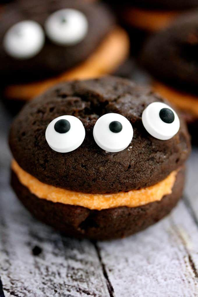 """<p>Little ones will love decorating these triple-eyed treats.</p><p><strong>Get the recipe at <a href=""""https://melaniemakes.com/mini-monster-chocolate-whoopie-pies-with-orange-cream-filling/"""" rel=""""nofollow noopener"""" target=""""_blank"""" data-ylk=""""slk:Melanie Makes"""" class=""""link rapid-noclick-resp"""">Melanie Makes</a>.</strong> </p>"""