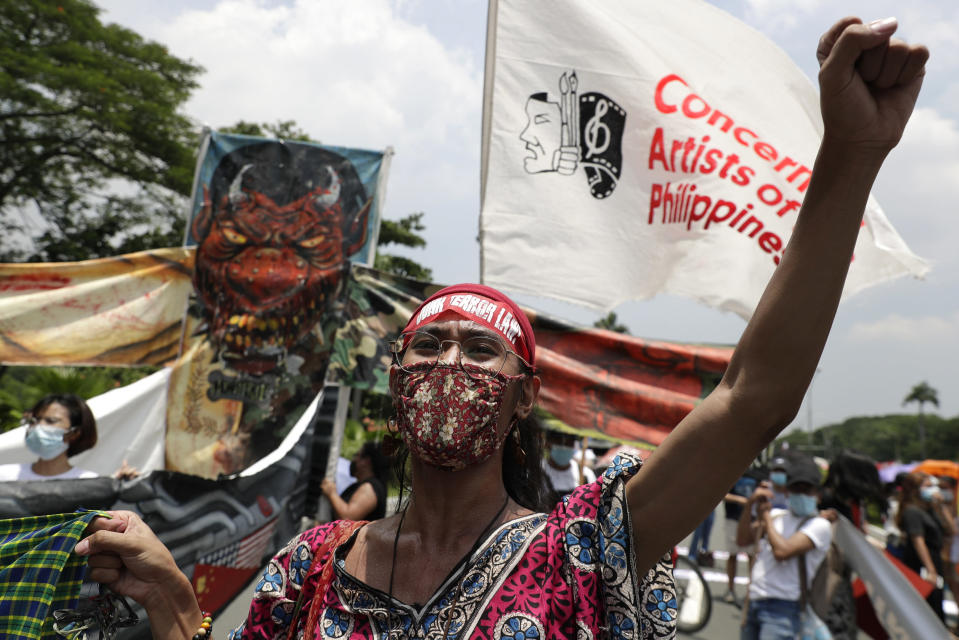 Protesters shout slogans as they hold a rally at the University of the Philippines against the 5th State of the Nation Address (SONA) by Philippine President Rodrigo Duterte on Monday, July 27, 2020 in Metro Manila, Philippines. Hundreds of protesters in the Philippine capital marched and staged motorcades Monday against a new anti-terror law and other issues despite police threats of arrests ahead of President Rodrigo Duterte's annual state of the nation speech.(AP Photo/Aaron Favila)