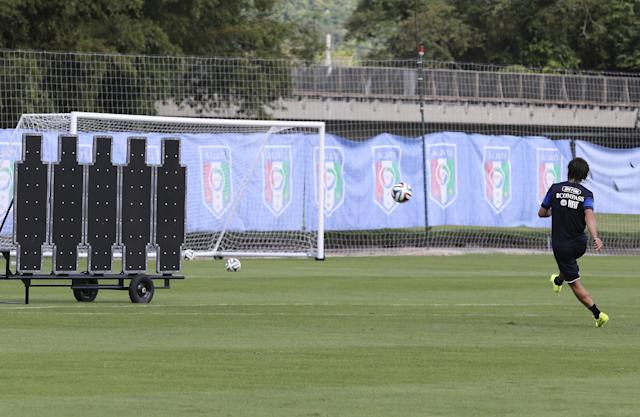 Italy's Andrea Pirlo practices shooting free kicks during a training session for the World Cup in Mangaratiba, Brazil, Wednesday, June 11, 2014. The international soccer tournament starts on Thursday. (AP Photo/Antonio Calanni)
