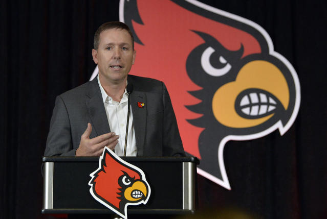 FILE - In this Dec. 4, 2018, file photo, Scott Satterfield speaks to the media and gathered fans following the announcement of his hiring as Louisville's new head NCAA college football coach in Louisville, Ky. The first-year Louisville coach changed the Cardinals football schedule to finish workouts before spring break. Satterfield has said he wants more time to evaluate the players he has and identify needs with rebuilding Louisville coming off a 2-10 season. (AP Photo/Timothy D. Easley, File)