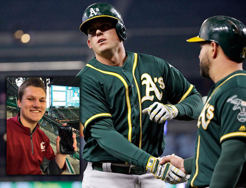 A huge homer by A's slugger Ryon Healy, center, led to a fan's broke fan, left. (AP/@meatpie97)