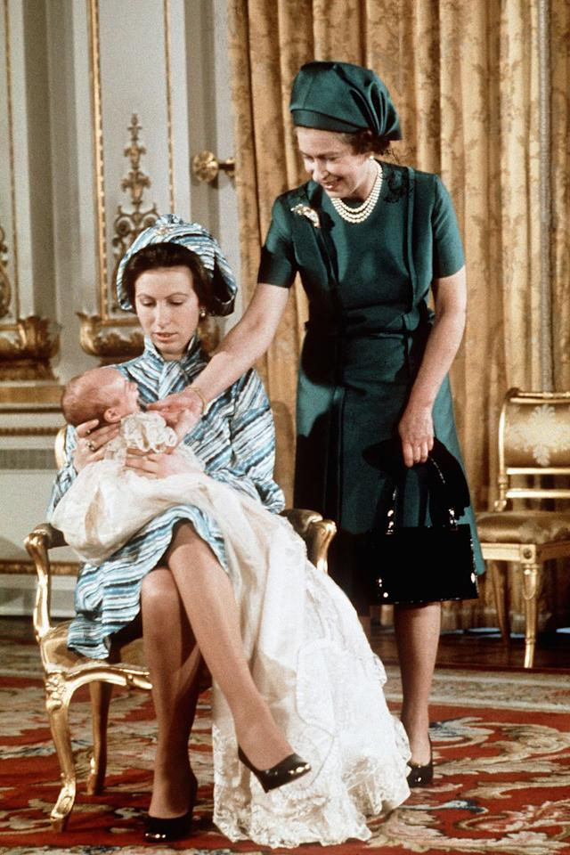 <p>Queen Elizabeth with her daughter Princess Anne and her first grandchild, Peter Phillips.</p>