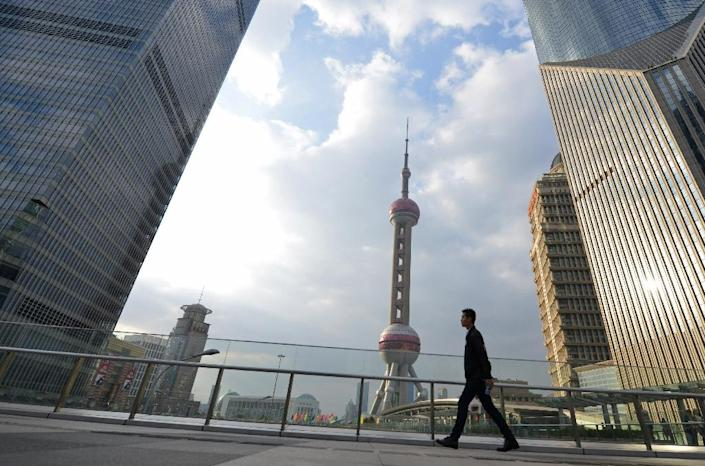 """China's """"Big Four"""" state-owned banks reported mounting bad loans in the first half of the year (AFP Photo/Peter Parks)"""