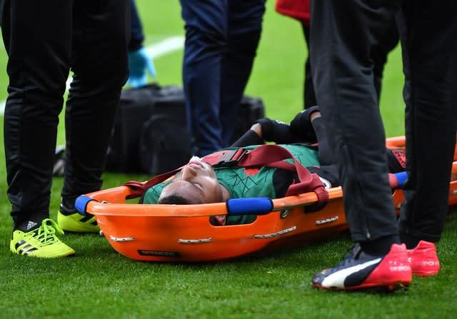 Aston Villa's Wesley on the floor on a stretcher after an injury during the Premier League match at Turf Moor, Burnley.