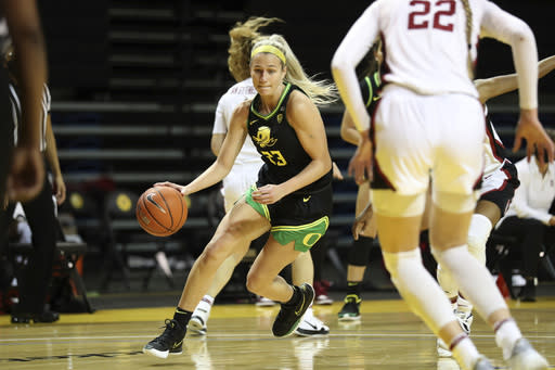 Oregon guard Maddie Scherr drives against Stanford during the first half of an NCAA college basketball game in Santa Cruz, Calif., Friday, Jan. 8, 2021. (AP Photo/Jed Jacobsohn)