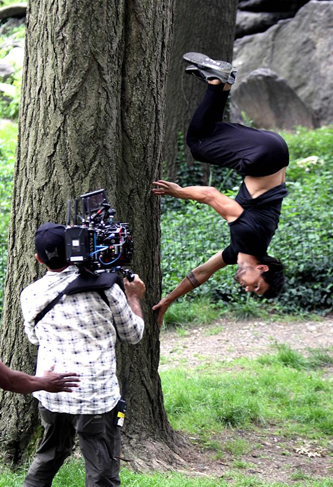 """Taylor Lautner pictured flipping around against a tree before jumping around the rocky mountains on the set of the """"Tracers"""" movie inside Central Park in Uptown, Manhattan. Pictured: Taylor Lautner Ref: SPL564226  180613  Picture by: Jose Perez/ Splash News   Splash News and Pictures Los Angeles:310-821-2666 New York:212-619-2666 London:870-934-2666 photodesk@splashnews.com"""