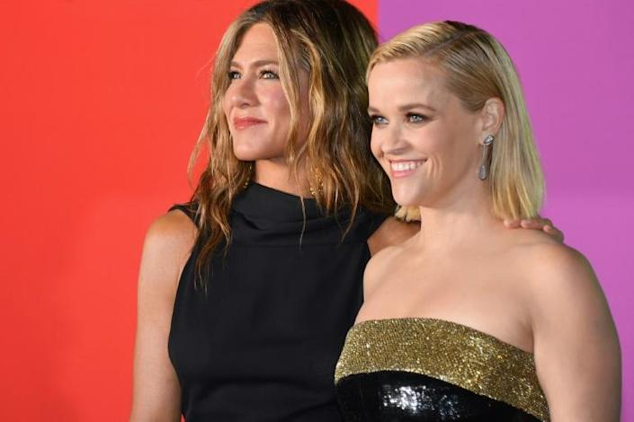 """""""The Morning Show,"""" about a newsroom hit by a #MeToo scandal, garnered Globes nods for stars Jennifer Aniston and Reese Witherspon, as well as for best drama (AFP Photo/Angela Weiss)"""