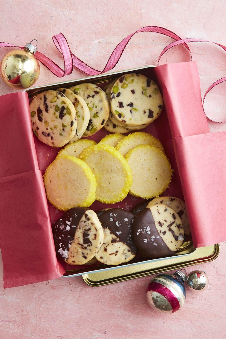 """<p>These sweet easy-to-make treats start with one dough that can then be turned into three different cookies.</p><p><strong><a href=""""https://www.countryliving.com/food-drinks/a34330858/slice-and-bake-shortbread-cookies/"""" rel=""""nofollow noopener"""" target=""""_blank"""" data-ylk=""""slk:Get the recipe"""" class=""""link rapid-noclick-resp"""">Get the recipe</a>.</strong></p><p><a class=""""link rapid-noclick-resp"""" href=""""https://www.amazon.com/Nordic-Ware-Natural-Aluminum-Commercial/dp/B0049C2S32/?tag=syn-yahoo-20&ascsubtag=%5Bartid%7C10050.g.647%5Bsrc%7Cyahoo-us"""" rel=""""nofollow noopener"""" target=""""_blank"""" data-ylk=""""slk:SHOP BAKING SHEETS"""">SHOP BAKING SHEETS</a></p>"""