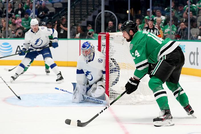 DALLAS, TEXAS - JANUARY 27: Jamie Benn #14 of the Dallas Stars controls the puck against Andrei Vasilevskiy #88 of the Tampa Bay Lightning in the first period at American Airlines Center on January 27, 2020 in Dallas, Texas. (Photo by Tom Pennington/Getty Images)
