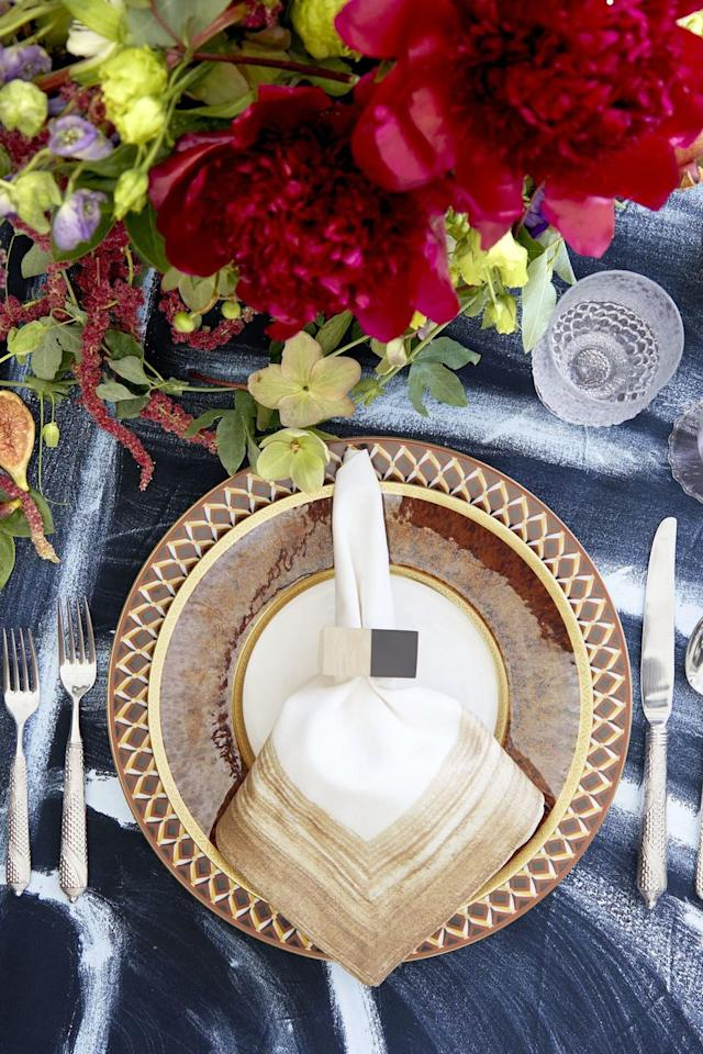"<p>Keep things sophisticated with unexpected colors that don't scream Halloween but still feature that fall aesthetic. A rich, blue tablecloth helps neutral plates pop. Add fresh flowers for even more color and stuck to an earthy palette with your plating and napkins to even it out.</p><p><a class=""body-btn-link"" href=""https://go.redirectingat.com?id=74968X1596630&url=https%3A%2F%2Ffood52.com%2Fshop%2Fproducts%2F5285-warm-tone-linen-napkins-set-of-4&sref=http%3A%2F%2Fwww.housebeautiful.com%2Fentertaining%2Fholidays-celebrations%2Fg21931391%2Fhalloween-table-decorations-centerpieces%2F"" target=""_blank"">BUY NOW</a>  <strong><em>Celina Mancurti Warm Tone Linen Napkins, $70</em></strong></p>"