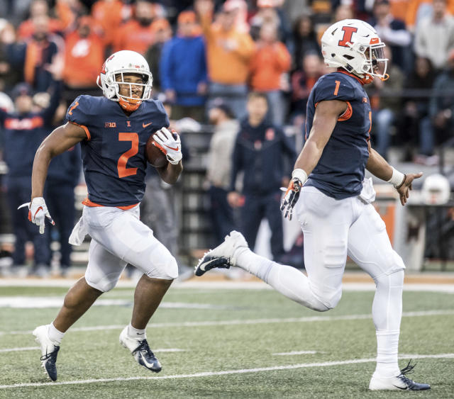 Illinois running back Reggie Corbin (2) is ushered into the end zone by teammate AJ Bush, Jr. in the second half of a NCAA college football game against Minnesota, Saturday, Nov. 3, 2018, in Champaign, Ill. (AP Photo/Holly Hart)