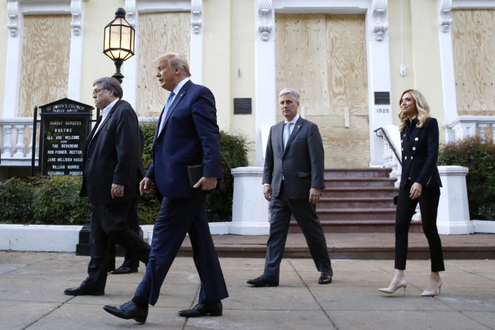 President Donald Trump departs after visiting outside St. John's Church across Lafayette Park from the White House Monday, June 1, 2020, in Washington. Part of the church was set on fire during protests on Sunday night. Walking with Trump are Attorney General William Barr, from left, White House national security adviser Robert O'Brien and White House press secretary Kayleigh McEnany. (AP Photo/Patrick Semansky)