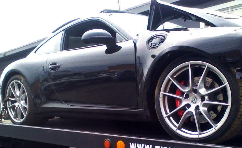 Lindsay Lohan's crashed Porsche lies on a flatbed tow truck, after it collided with a truck on Pacific Coast Highway in Santa Monica, Calif., Friday, June 8, 2012. Santa Monica police say the accident occurred around 11:45 a.m. and an investigation is ongoing. Lindsay Lohan's spokesman says the actress is fine after being released from an area hospital. (AP Photo)