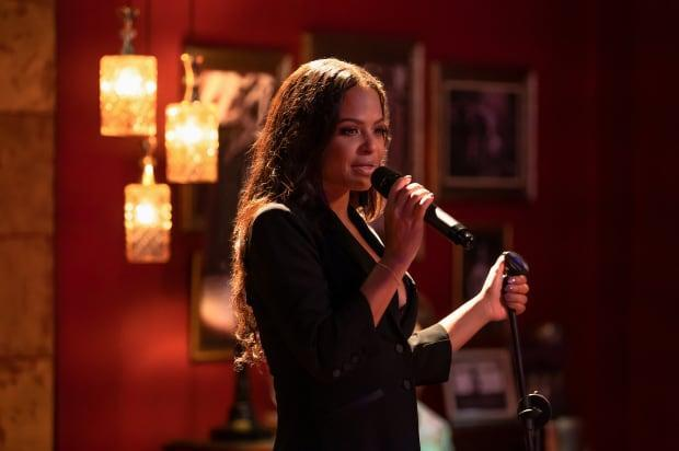 Milian as Erica singing producer Alicia Keys's hit, 'No One' in 'Resort to Love.'<p>Photo: Courtesy of Netflix</p>
