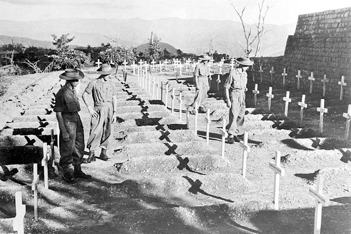 Men of the Royal West Kent Regiment pay silent tribute to comrades who fell in the Battle for Kohima, 27 November 1945