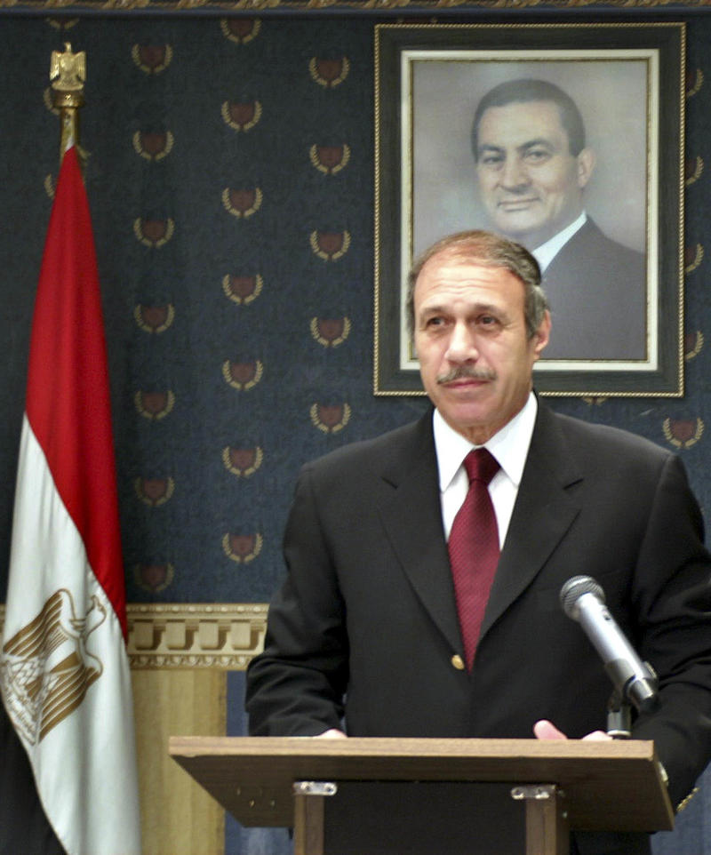 FILE - In this May 26, 2005 file photo distributed by the Egyptian Interior Ministry, Interior Minister Habib al-Adly, standing under a portrait of Egyptian President Hosni Mubarak, announces the results of the national referendum in Cairo, Egypt. Former Egyptian President Hosni Mubarak's top security official, Interior Minister Habib al-Adly, was convicted Thursday, May 5, 2011 of corruption and money laundering and sentenced to 12 years in prison.  The conviction of former Interior Minister Habib al-Adly was the first against any of the some two dozen Mubarak-era Cabinet ministers and regime-linked businessmen who have been detained since Mubarak's Feb. 11 ouster. (AP Photo/Egyptian Interior Ministry, File)