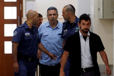 File Photo: Gonen Segev, a former Israeli cabinet minister indicted on suspicion of spying for Iran, is escorted by prison guards as he arrives to court in Jerusalem