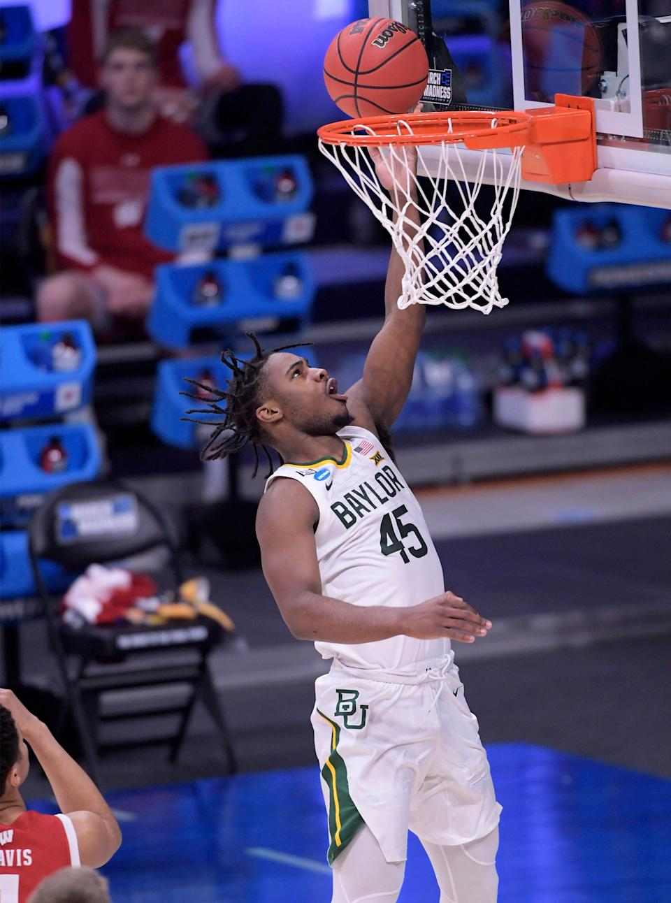 Baylor guard Davion Mitchell says the extra practice time before the NCAA Tournament - courtesy of an early exit from the Big 12 tournament - helped the Bears tighten up their defense.