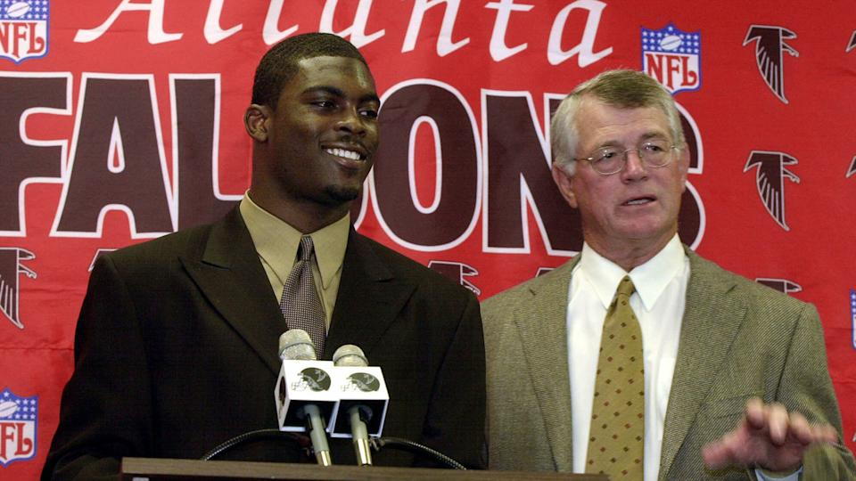 Mandatory Credit: Photo by Ric Feld/AP/Shutterstock (6468566a)VICK FALCONS REEVES Atlanta Falcons first round pick Michael Vick, left, and head coach Dan Reeves talk to members of the media at a press conference at the Falcons Flowery Branch, Ga.
