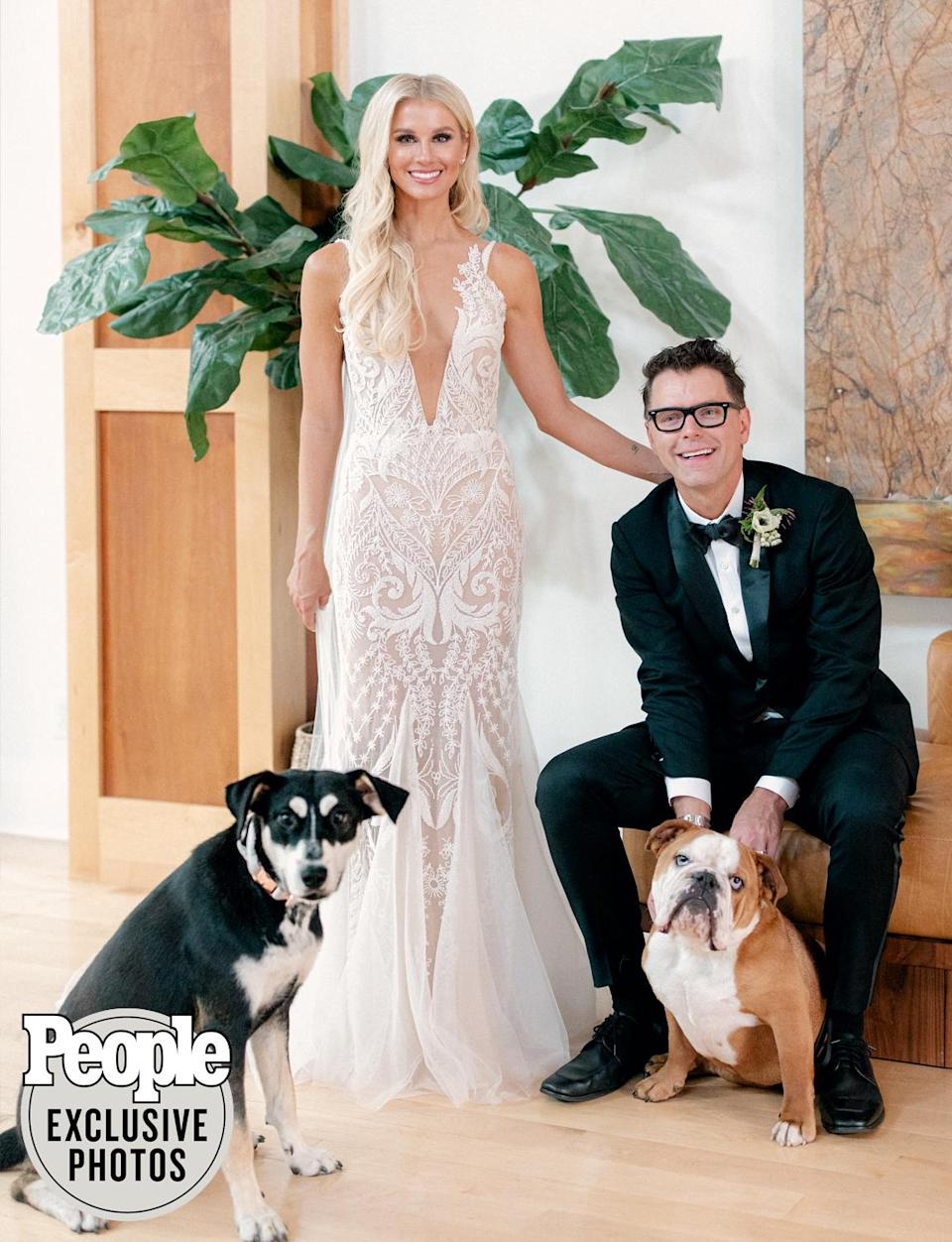 <p>Parker and Bones pose with their pups Eller and Stanley.</p>