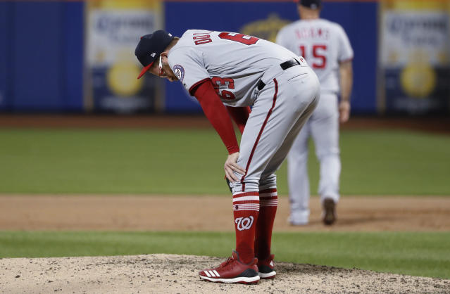 Washington Nationals relief pitcher Sean Doolittle reacts after allowing a three-run home run to New York Mets' Rajai Davis during the eighth inning of a baseball game Wednesday, May 22, 2019, in New York. The Mets won 6-1. (AP Photo/Kathy Willens)