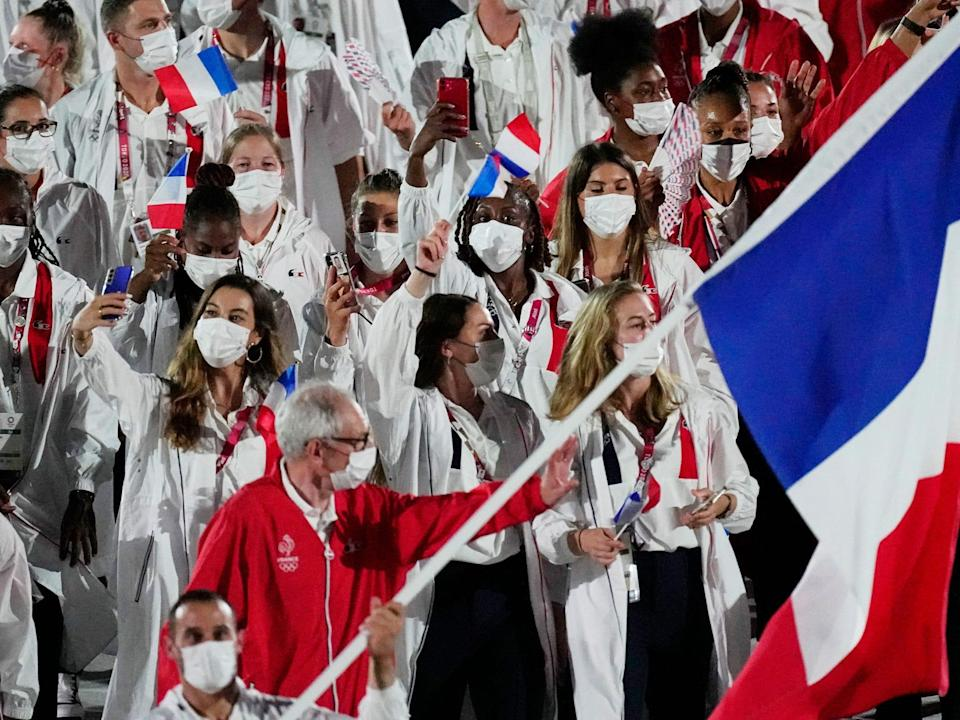 Athletes from France make their entrance at the Summer Olympics.