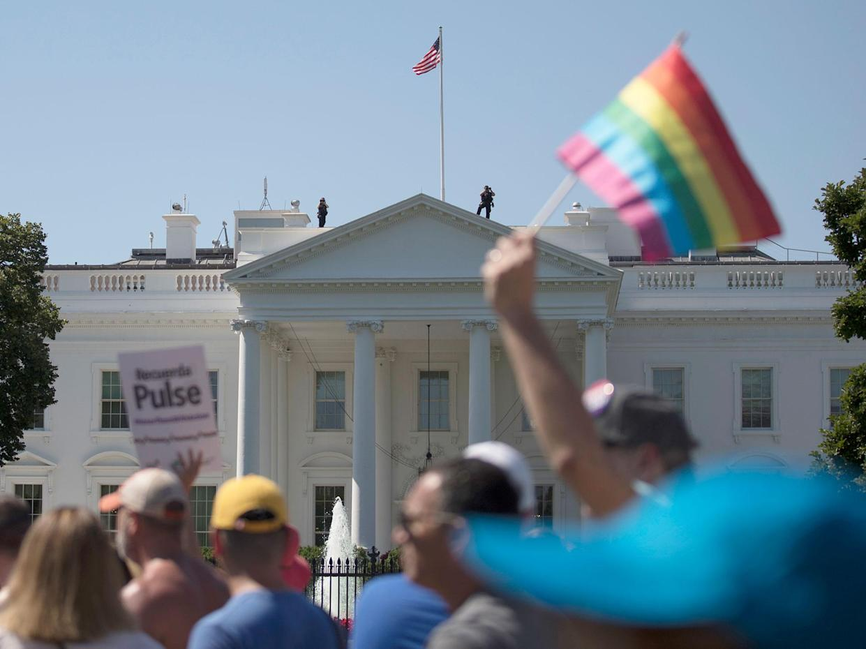 Equality March for Unity and Pride participants march past the White House on June 11. (Photo: Carolyn Kaster/AP)