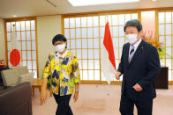 Indonesia's Foreign Minister Retno Marsudi, left, walks with Japan's Foreign Minister Toshimitsu Motegi as they head to the Japan Indonesia Foreign Ministers meeting in Tokyo on Monday, March 29, 2021. Indonesian Foreign Minister Retno Marsudi and Defense Minister Prabowo Subianto are in Japan from March 28-30, 2021. (David Mareuil/Pool Photo via AP)