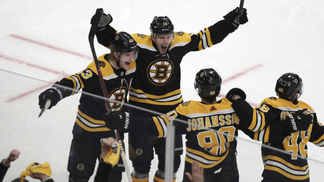 Boston Bruins center Charlie Coyle, center, celebrates with teammates after his game-winning goal off Columbus Blue Jackets goaltender Sergei Bobrovsky during overtime of Game 1 of an NHL hockey second-round playoff series, Thursday, April 25, 2019, in Boston. The Bruins won 3-2. (AP Photo/Charles Krupa)