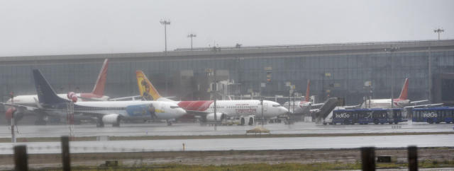 MUMBAI, INDIA - JUNE 3: Airplane parked at chhatrapati shivaji maharaj international airport as No landing scheduled from 2.30pm to 7pm due to Cyclone alert on June 3, 2020 in Mumbai, India. Alibaug witnessed wind speeds of up to 120 kilometres per hour. Although the cyclone made the landfall just 95 kilometres from Mumbai, the Maharashtra capital largely escaped its wrath. (Photo by Satyabrata Tripathy/Hindustan Times via Getty Images)