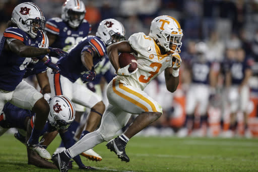Tennessee running back Eric Gray (3) caries the ball during the first half of the team's NCAA college football game against Auburn on Saturday, Nov. 21, 2020, in Auburn, Ala. (AP Photo/Butch Dill)