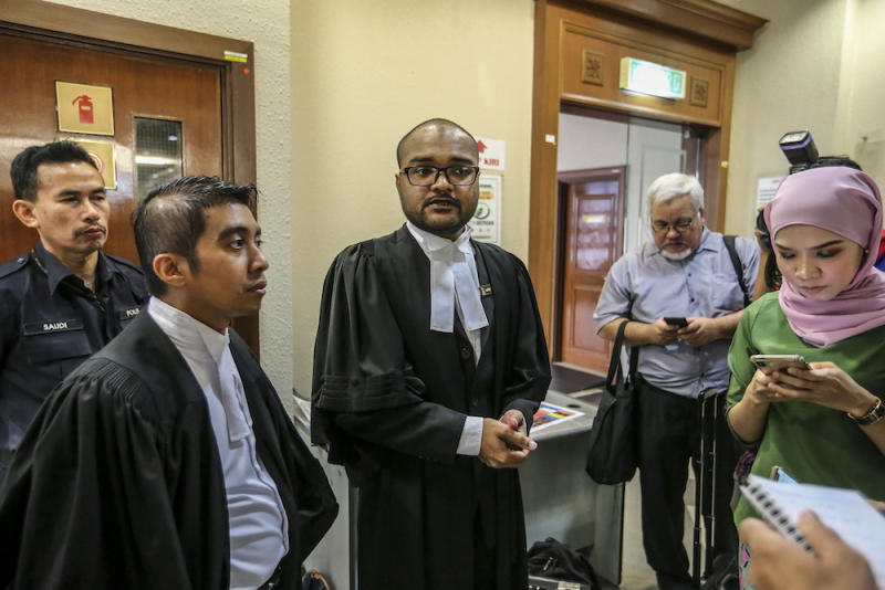 Deputy Public Prosecutor Aaron Chelliah speaks to reporters about the forfeiture action of RM48 million by the government on Tan Sri Larry Low Hock Peng in the High Court in Kuala Lumpur July 19, 2019. — Picture by Firdaus Latif