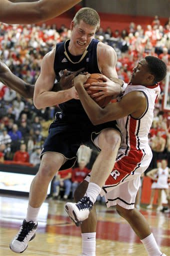 Notre Dame's Scott Martin, left, drives against Rutgers' Myles Mack during the first half of an NCAA college basketball game, Monday, Jan. 16, 2012, in Piscataway, N.J. (AP Photo/Julio Cortez)