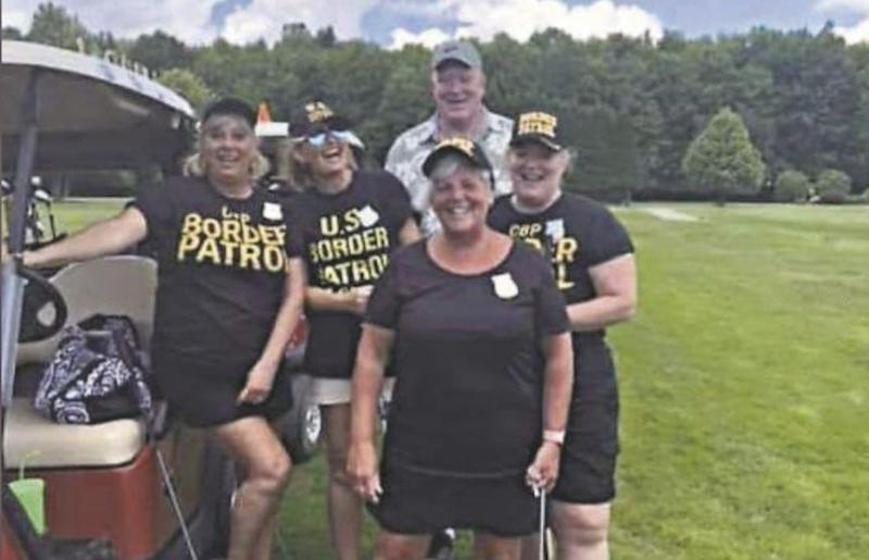 """The golf team wore black t-shirts and hats emblazoned with the words """"border patrol"""" and drove a cart decorated as the U.S. Mexico border wall. (Credit: Erie News Now)"""